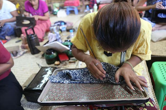 local artisan in lacquerware workshop in bagan
